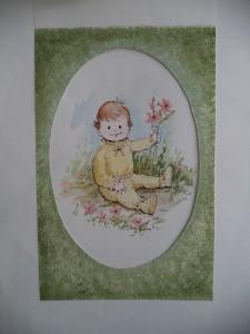 Babytje met bloemen in een bloemenweide