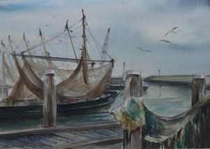 De KG 5 vissersboot in de haven met visnetten
