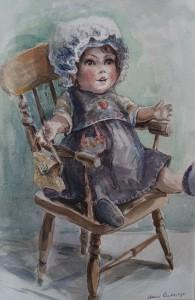 Pop in een stoeltje