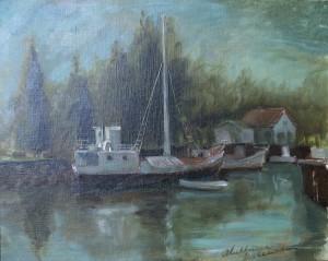 Havengezichtje met boot en dennebomen
