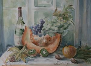Stilleven met pompoen, fruit en wijnfles